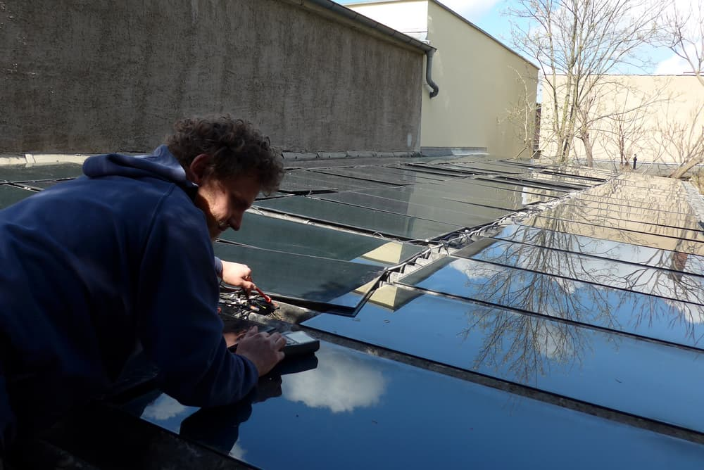 Bodhi connecting the solar panels
